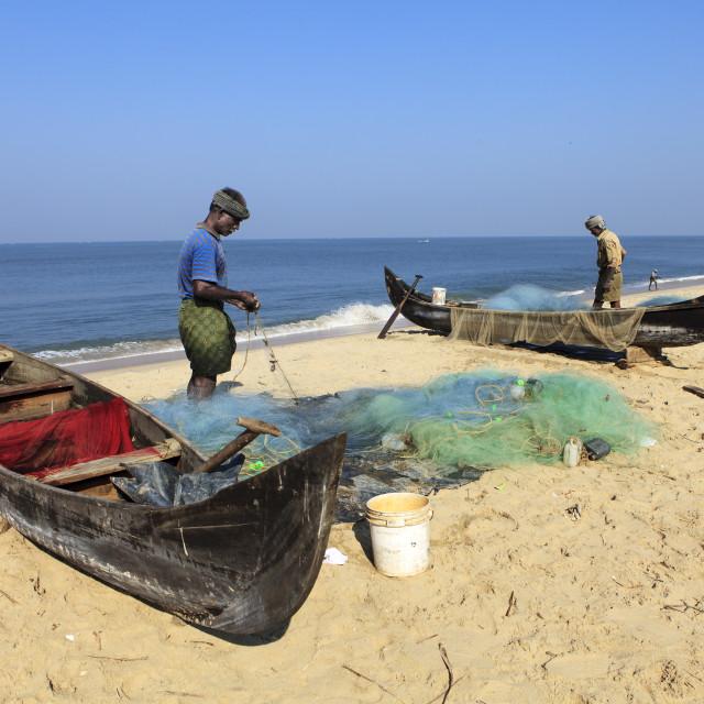 """fishermen preparing their nets"" stock image"