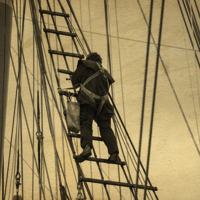 """""""A ship's rigger at work"""" stock image"""