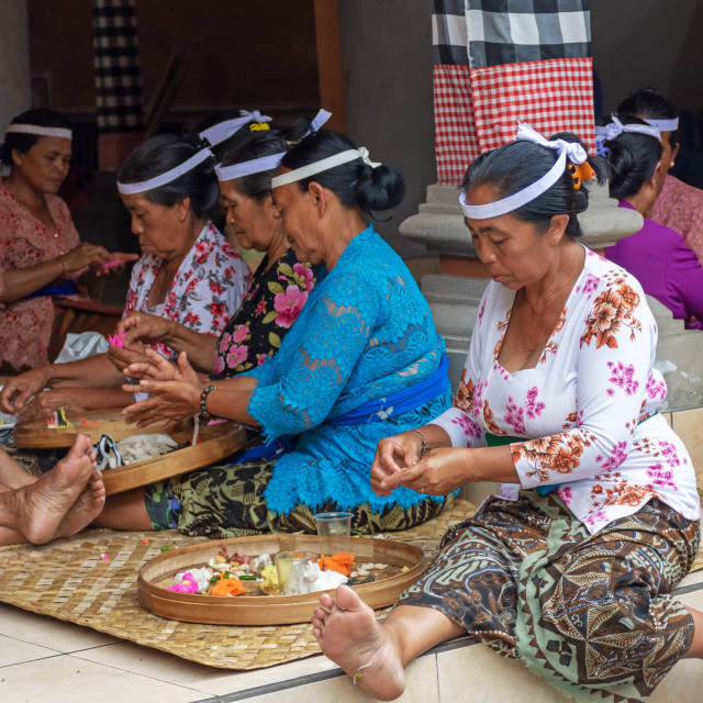 """Balinese women gathering for preparation of religious event"" stock image"