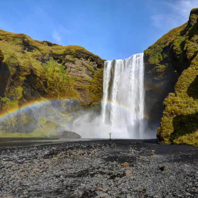 """Hiker at Skogafoss With Rainbow"" stock image"