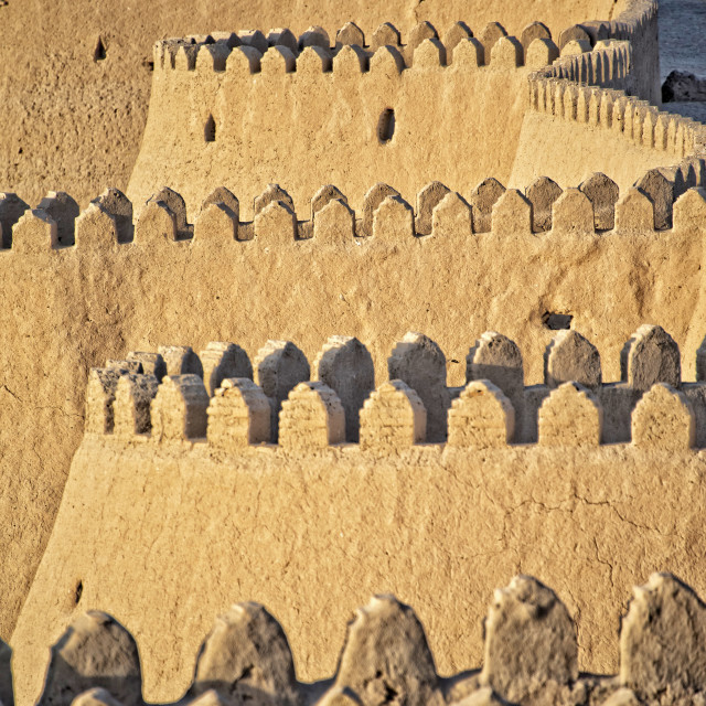 """The wall of the Ichon Qala at dusk; Khiva"" stock image"