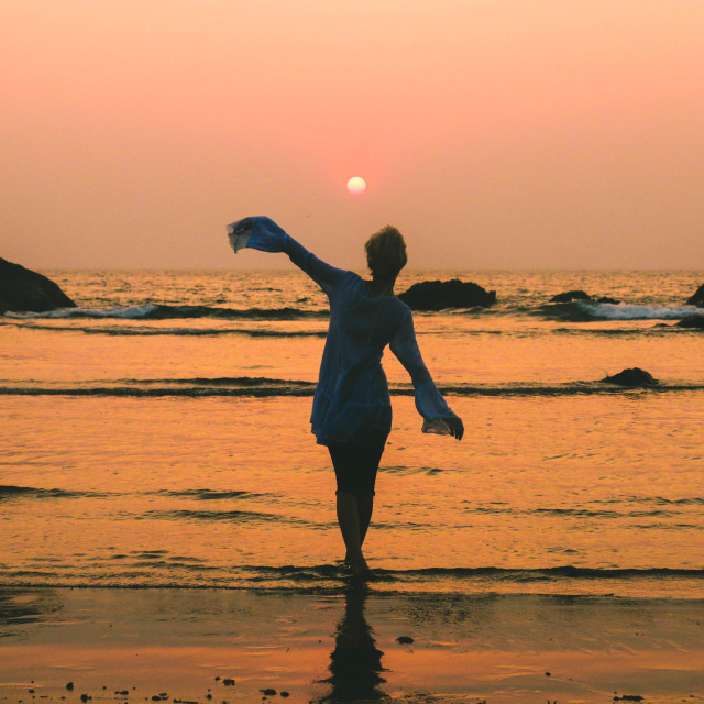 """Girl dancing at the beach sunset"" stock image"
