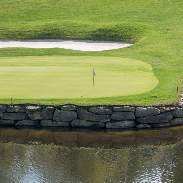 """""""Challenging hole on luxury golf course with water and sand"""" stock image"""