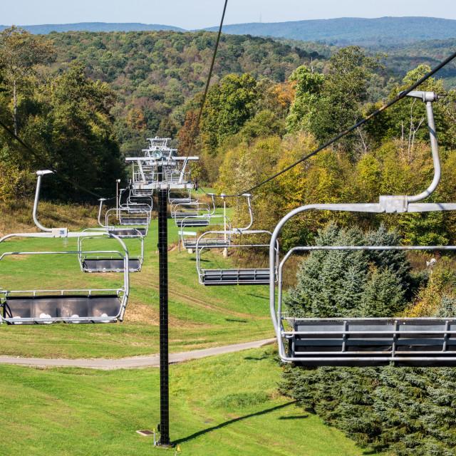 """Empty ski lift on bright sunny autumn day"" stock image"