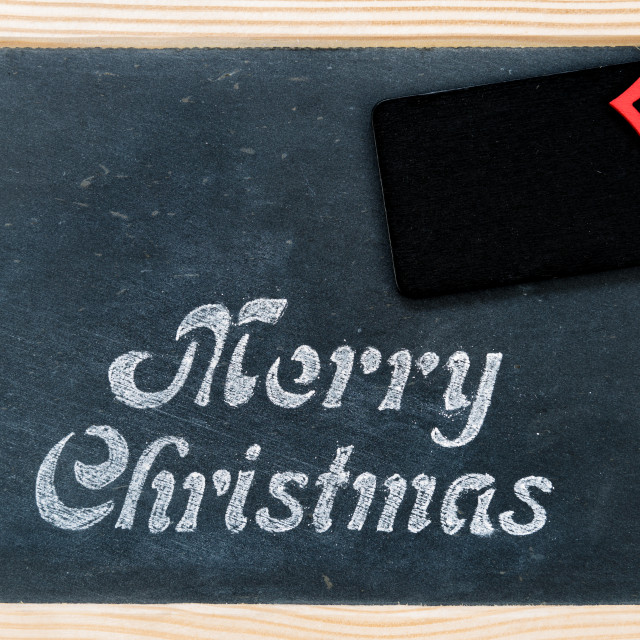 """Wooden frame vintage chalkboard with Merry Christmas message, tag and red..."" stock image"