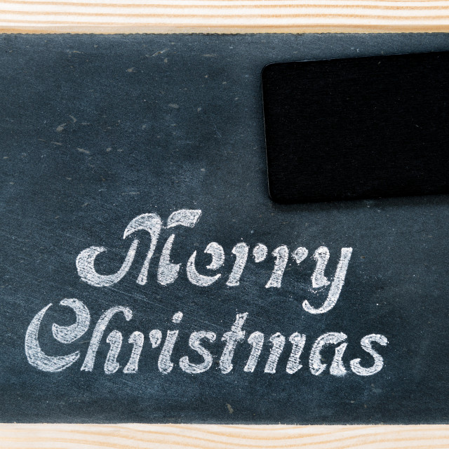 """Wooden frame vintage chalkboard with Merry Christmas message and blank tag"" stock image"