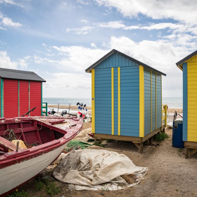 """Fishing boats and beach huts"" stock image"