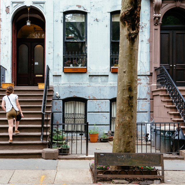 """Woman at classic old apartment building in Greenwich Village"" stock image"