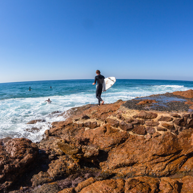 """Surfer Going Surfing Ocean Rocks"" stock image"