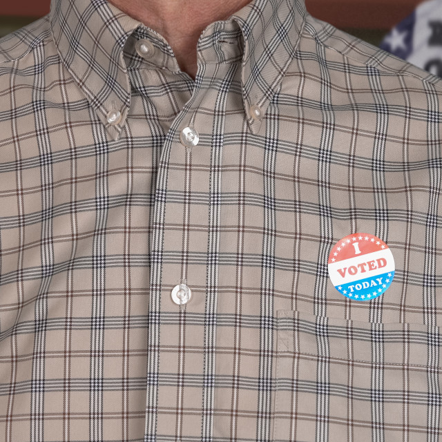 """""""Senior caucasian man in casual clothing with Voted sticker"""" stock image"""