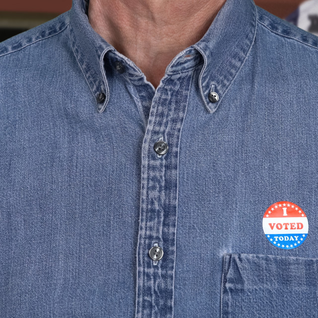 """""""Senior caucasian man in working clothing with Voted sticker"""" stock image"""