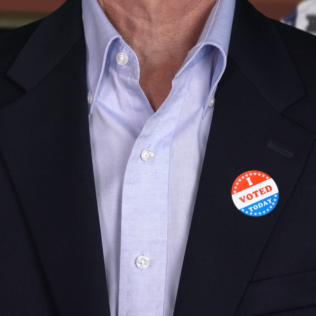 """""""Senior caucasian man in formal clothing with Voted sticker"""" stock image"""