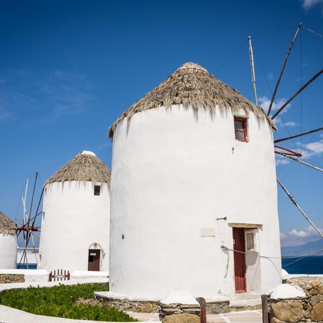 """Iconic windmills on Mykonos Island Greece"" stock image"