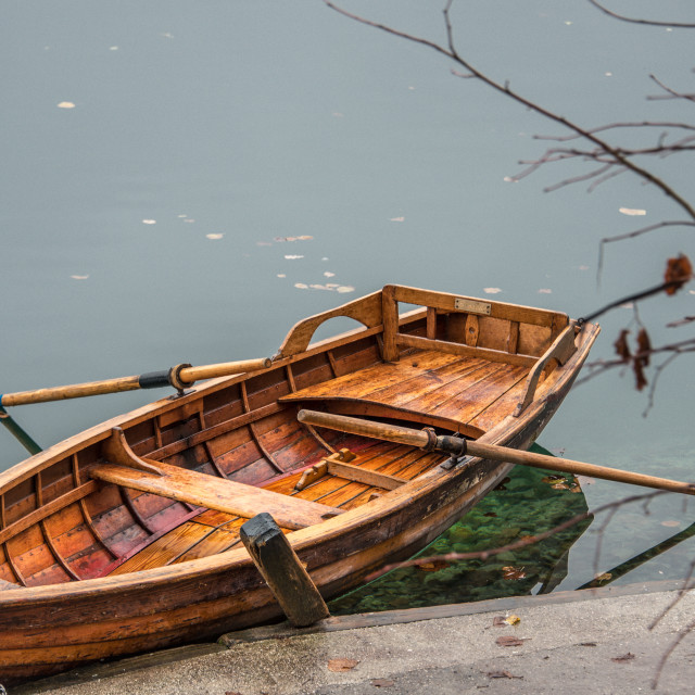 """Wooden row boat on a lake"" stock image"