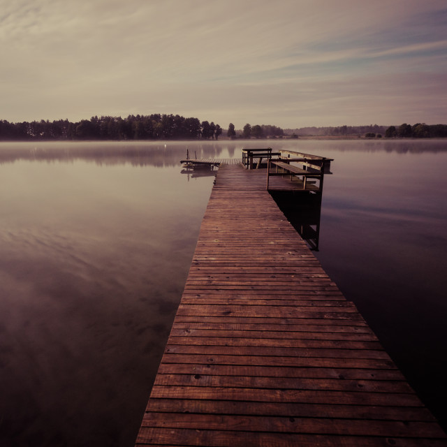 """""""Wooden jetty on the lake at night, long exposure shot"""" stock image"""