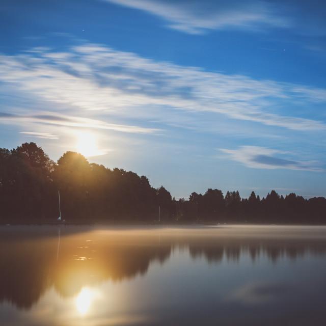 """Full moon over the lake, long exposure shot"" stock image"