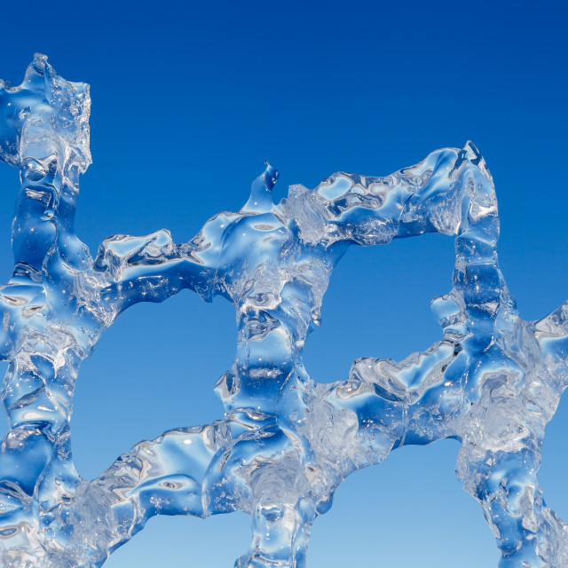 """""""Fence made of ice against blue sky abstract background"""" stock image"""