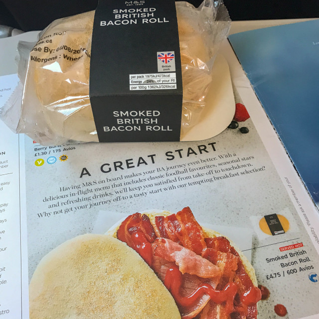 """""""In-flight menu and hot bacon roll"""" stock image"""