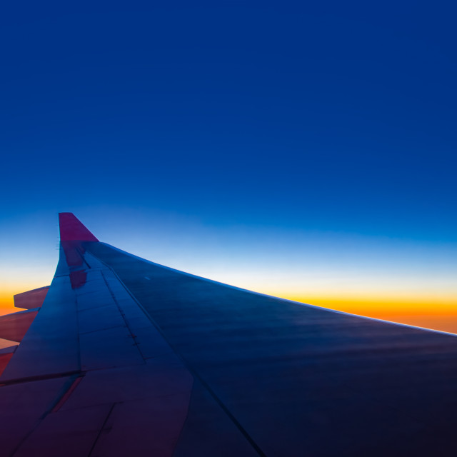 """""""Sunset sky from the airplane window at height 35,000 feet."""" stock image"""