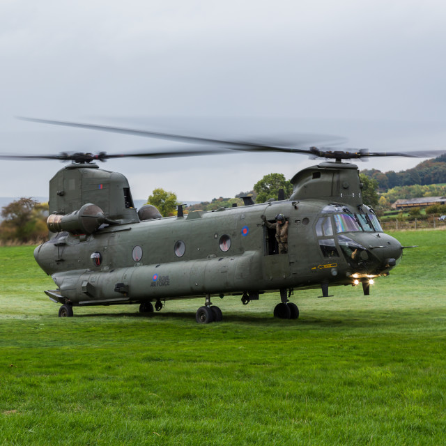 """RAF Chinook helicopter lifts into the sky"" stock image"