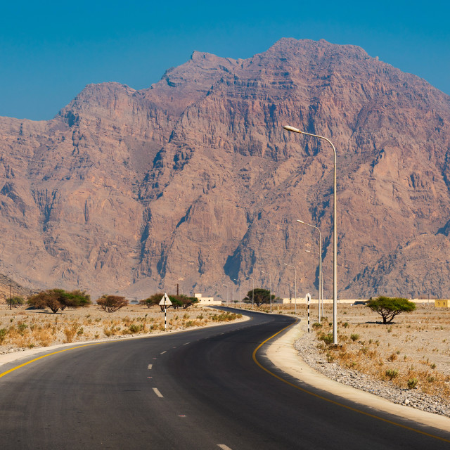 """Scenic desert road in Musandam Oman"" stock image"