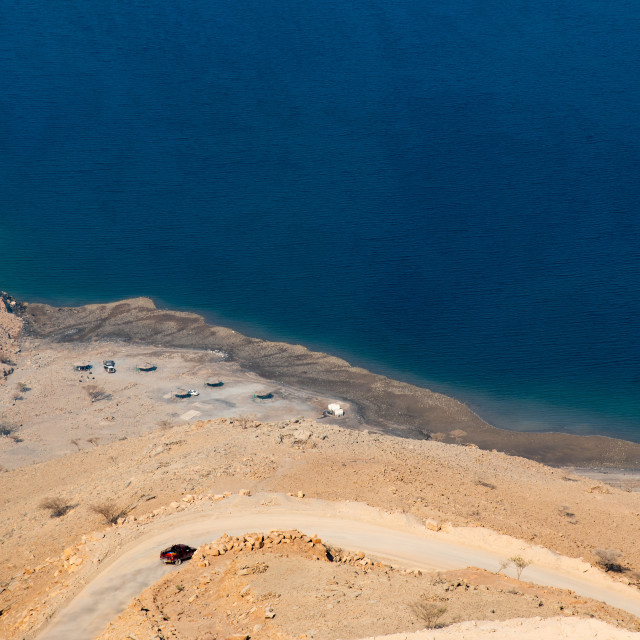 """""""Car on the sand road at Fjord Khor Najd in Oman"""" stock image"""