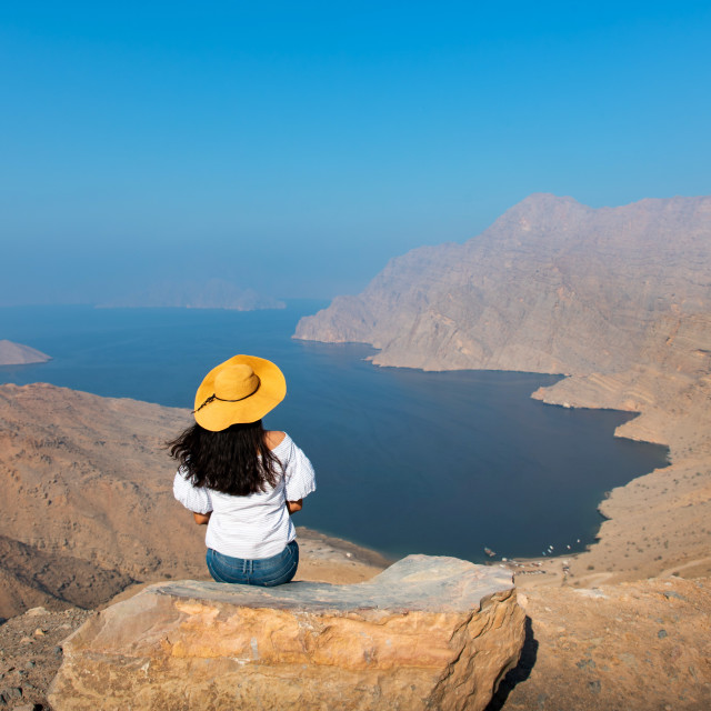 """""""Woman enjoying view over Fjord Khor Najd in Oman"""" stock image"""