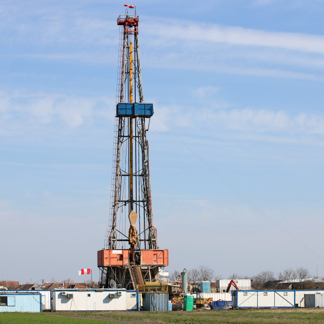 """""""Land oil drilling rig on field"""" stock image"""