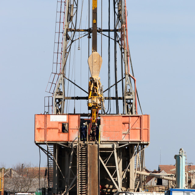 """""""oil drilling rig with workers"""" stock image"""