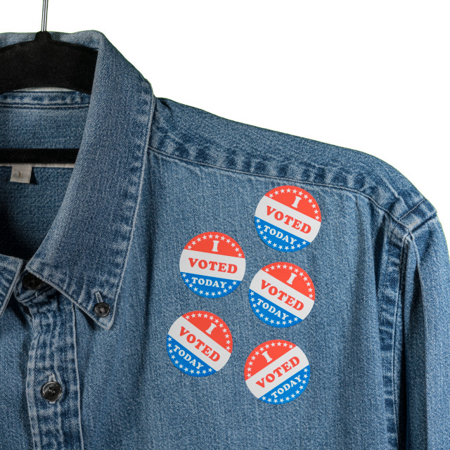 """""""Blue denim working clothing with many Voted stickers on white background"""" stock image"""
