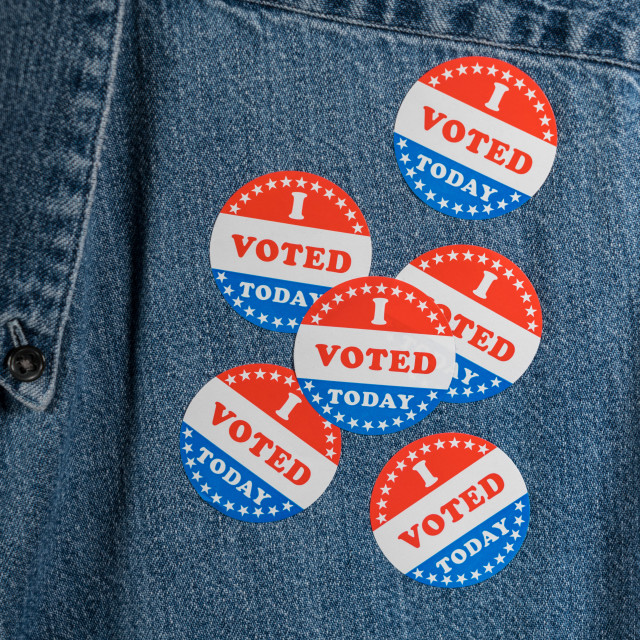 """""""Blue denim working clothing with many Voted stickers"""" stock image"""