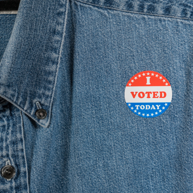"""""""Blue denim working clothing with I Voted sticker"""" stock image"""