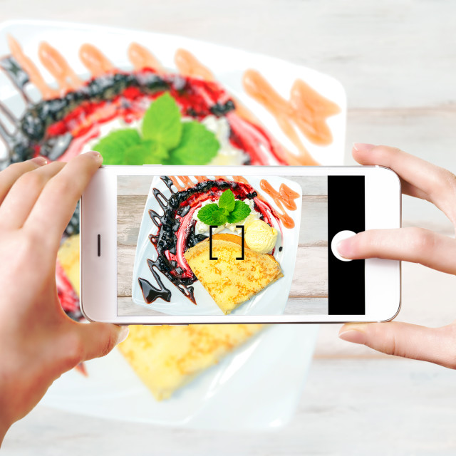 """""""Making culinary photos on smartphone"""" stock image"""