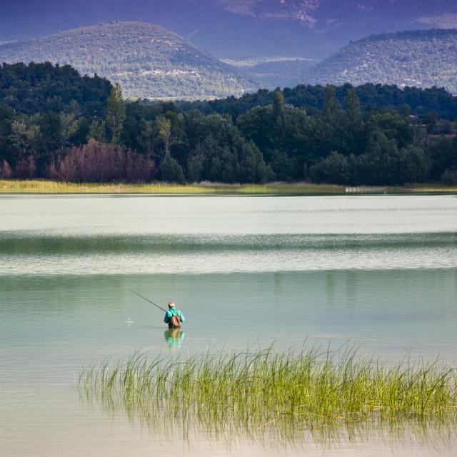 """Fishing in Etang de la Bonde"" stock image"