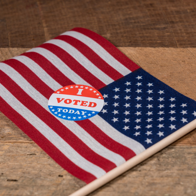 """""""I Voted Today paper sticker on US Flag and rural wooden table"""" stock image"""