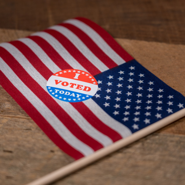 """""""Narrow focus on I Voted Today paper sticker on US Flag"""" stock image"""
