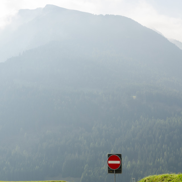 """Road signs in misty mountains"" stock image"