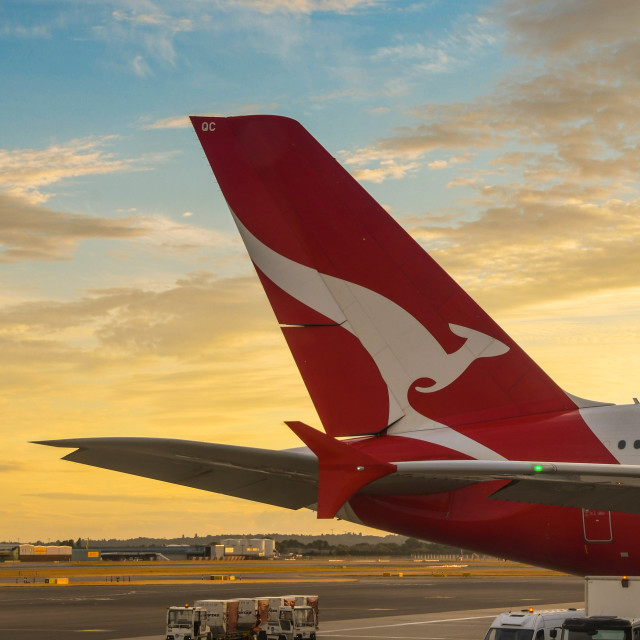 """""""Tail fin of Qantas airliner at sunset"""" stock image"""