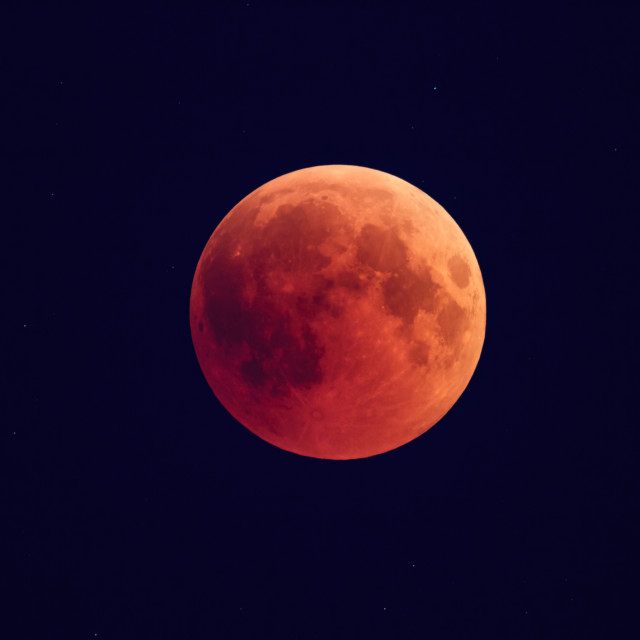 """""""Super Bloody Moon, full eclipse phase against starry sky background"""" stock image"""