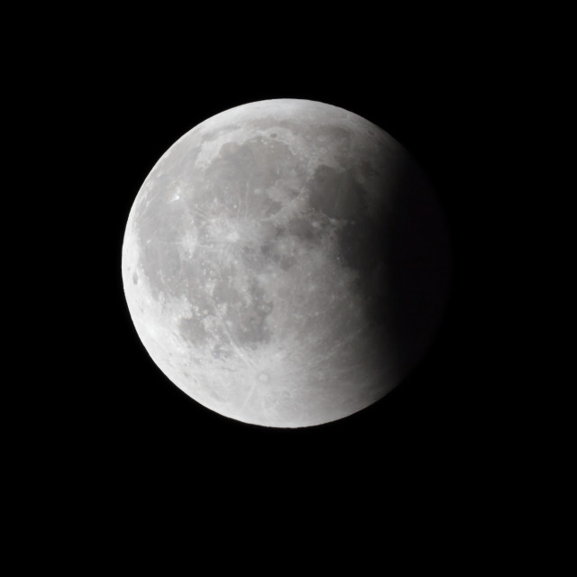 """""""Super Bloody Moon, full eclipse last phase against black sky background, quarter of the Moon surface covered by Earth's shadow"""" stock image"""