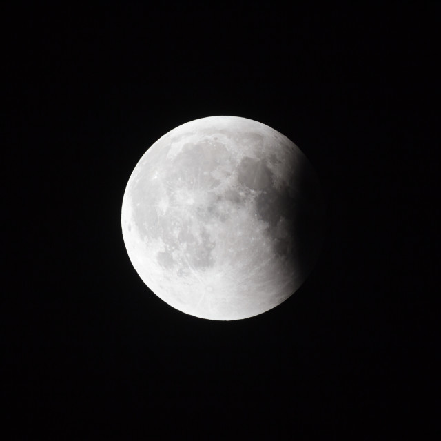 """""""Super Bloody Moon, full eclipse last phase against black sky background, small part of Moon surface covered by Earth's shadow"""" stock image"""