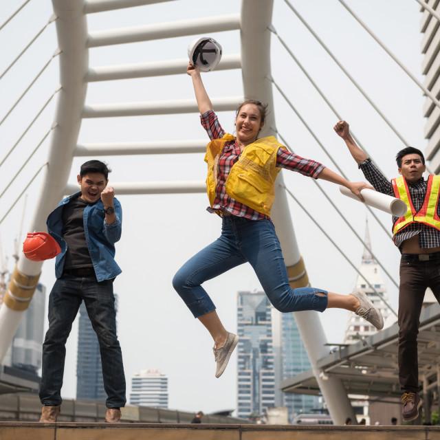"""Happy engineer team jump in city"" stock image"