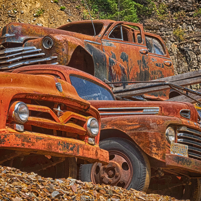 """Old cars in junk yard"" stock image"