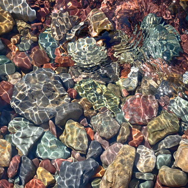 """Colorful rocks under water"" stock image"