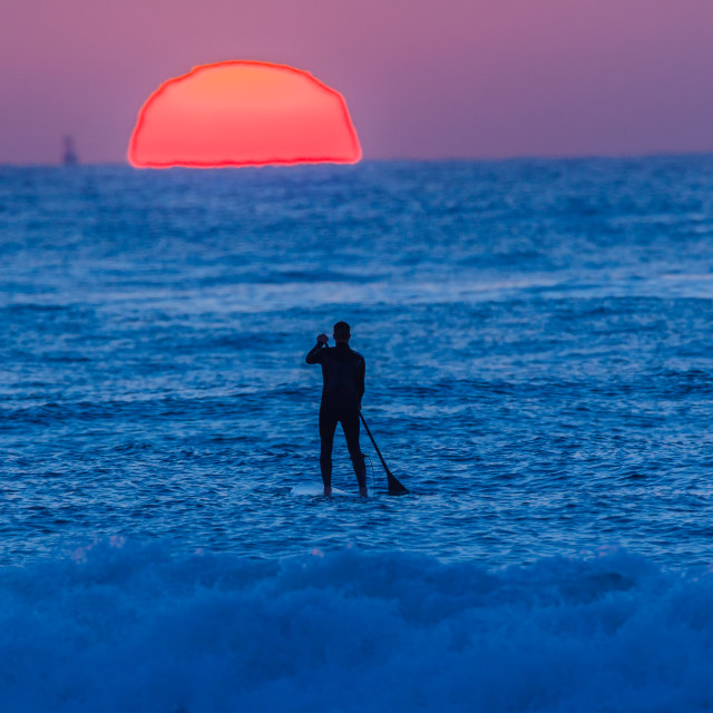 """Surfer Paddle Board Ocean Horizon Sunrise"" stock image"