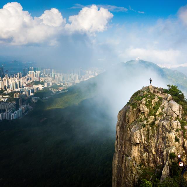 """Man enjoying Hong Kong city view from the Lion rock aerial"" stock image"