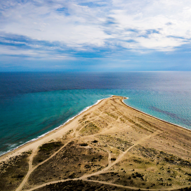 """""""Triangle shaped beach leading into water aerial"""" stock image"""