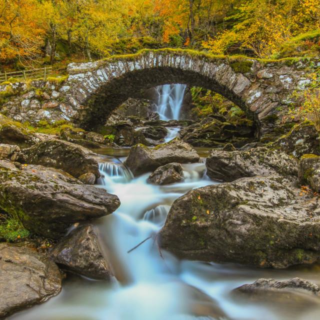 """Falls of Allt da Ghob and Roman bridge in Glen Lyon"" stock image"