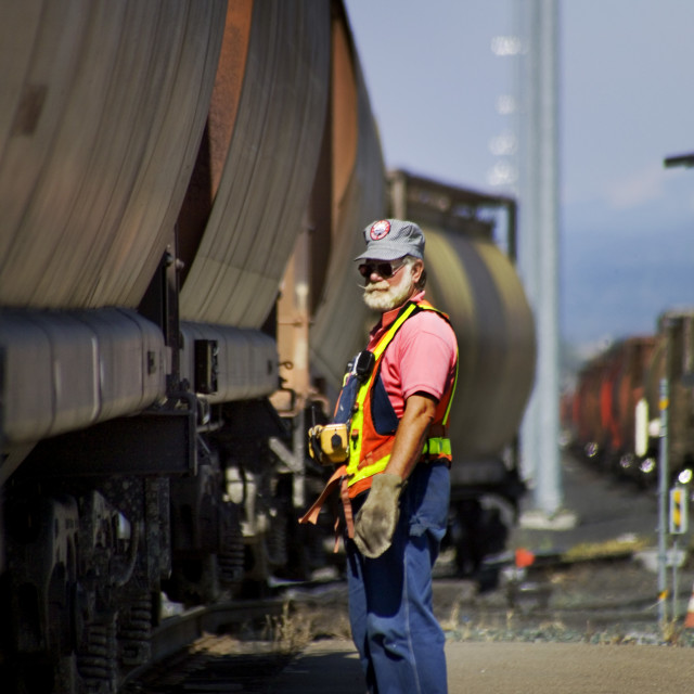 """A bearded hump trim foreman in a Roseville, CA, railway classification yard..."" stock image"