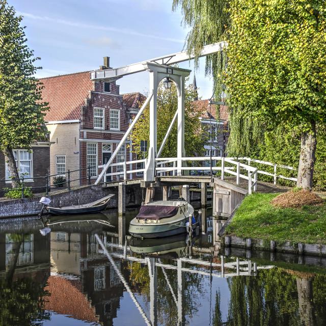 """Drawbridge and houses reflecting"" stock image"